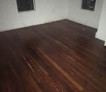Old heart pine wood flooring before sanding