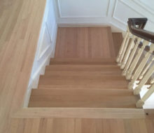 After sanding and hand scraping wood flooring, stair treads, and landings