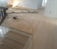 Sanded and hand scraped second floor red oak flooring and stair treads