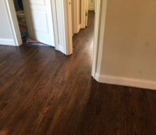 Sanded, stained, and refinished red oak plank flooring