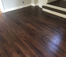 Sanded, stained, and refinished red oak plank flooring & stair treads