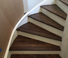 Sanded, stained, and refinished stair treads