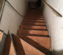 Sanding old wooden stair treads