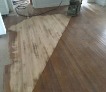 Sanding old red oak wooden flooring