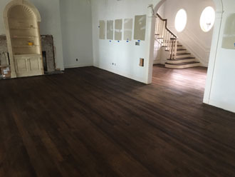 Stained and refinished red oak wood flooring and stair treads