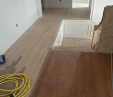 Weave-in repair of red oak wood flooring on the second floor of project home