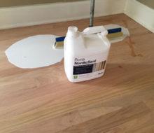 Applying Bona NordicSeal to sanded red oak wood flooring