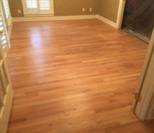 Old, yellowed red oak wood flooring prior to refinishing