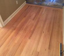Sanded red oak wood flooring.