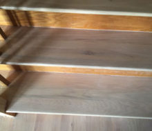 Whitewashed refinished wooden stair treads.