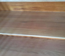 Whitewashed refinished wooden stair treads - detail.
