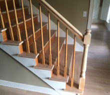 Whitewashed refinished stair rails and newel posts.