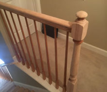 Sanded stair rails and newel posts.