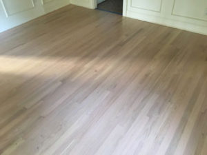 Whitewashed refinished red oak wood flooring.