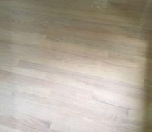Whitewashed refinished red oak wood flooring.