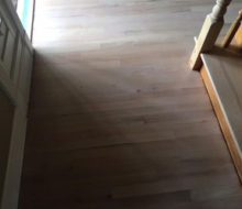 Whitewashed refinished red oak wood flooring and stair treads.