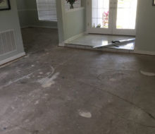 Bare concrete subfloor - carpet removed
