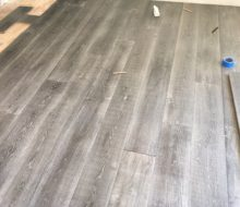 Beachy look White Oak flooring being installed
