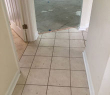 Carpeting removed, tile coming out