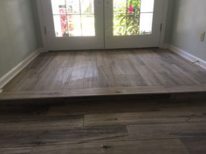 Hickory wood look floor tile installed - elevated floor/step