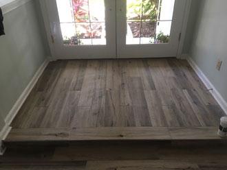 hickory wood look floor tile installed elevated floorstep