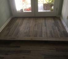 Hickory wood look floor tile installed - elevated floor/step