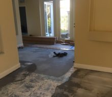 Installing quarter sawn red oak wood flooring on the leveled concrete subfloor