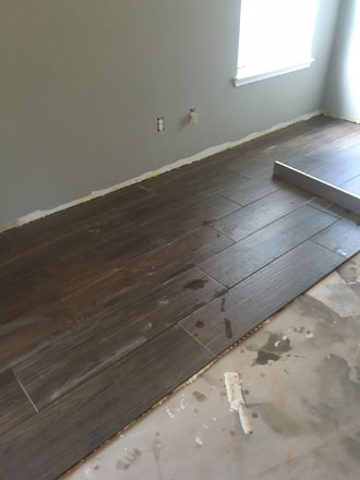 Wood look tiles and river rock installation in atlantic beach for Installing river rock tile