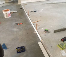 Preparing to level elevated/stepped floor