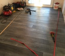 Strapped beachy look White Oak flooring being installed