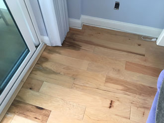 water damaged hickory wood flooring