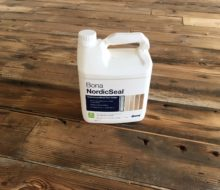 Bona NordicSeal sealer container on reclaimed Heart Pine floor