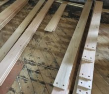 Red oak planks drilled for walnut pegs