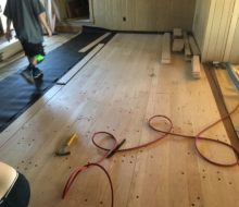 Red oak planks with walnut pegs being installed
