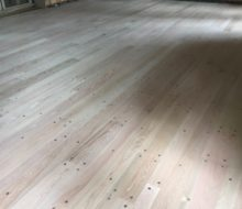 Sanded solid red oak plank, walnut pegged floor