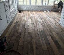 Varied length and width reclaimed heart pine flooring installed