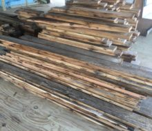 Various length/width reclaimed heart pine flooring prior to installation