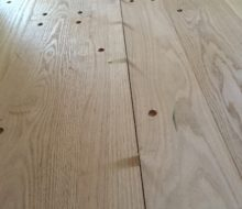 Walnut pegged red oak plank flooring w/ coin spacers