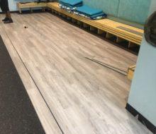 Installing vinyl plank flooring in Manatee Cafe