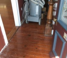 More water damaged old heart pine plank flooring - hallway