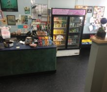Old, dark tile floor - Manatee Cafe, St. Augustine, Florida.