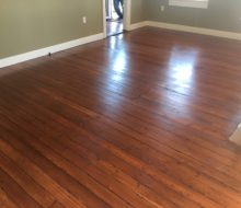 Refinished and restored old heart pine plank flooring