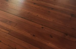 Refinished old heart pine plank flooring