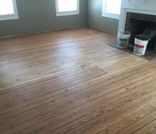 Sanded water damaged old heart pine plank flooring