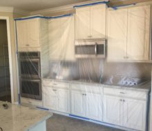 Sealing cabinets and appliances with plastic film during tile removal