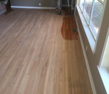 Applying finish to sanded solid red oak clear grade flooring
