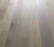 Installed wire brushed oak hardwood flooring