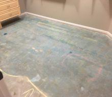 Leveling concrete slab for wood flooring