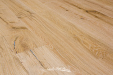 Snow Cap wire brushed White Oak flooring by Naturally Aged Flooring.