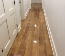 Stained and finished character grade White Oak flooring